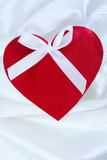Red heart  on white satin Stock Photography