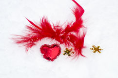 Red heart on white snow Stock Photo