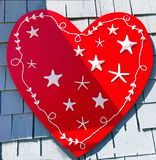 A red heart with white starfish stock image