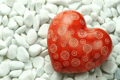 Red Heart on white stones Stock Images