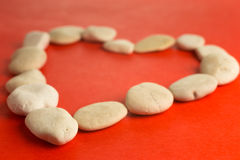 Red heart with white stones Stock Photo