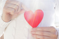Red heart on a white sweater Stock Photography