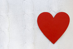 Red heart on a white sweater Stock Photos
