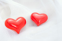 Red heart on a white veil Royalty Free Stock Photos