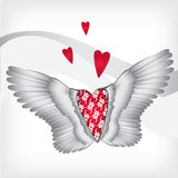 Red heart with wings. Red ornamental heart with wings on a light background Stock Image
