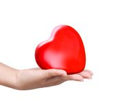 Red heart at the woman hand Stock Photos
