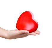 Red heart at the woman hand Royalty Free Stock Images