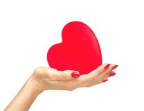 Red heart in woman hand isolated on white Royalty Free Stock Photos