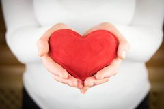 Red  heart in woman hands Royalty Free Stock Image