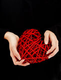 Red heart in woman hands Royalty Free Stock Images