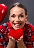 Red heart in woman hands stock image