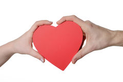 Red heart in woman and man hands Royalty Free Stock Image