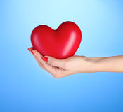 Red heart in woman's hand Stock Images
