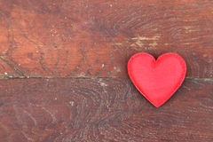 Red heart on wood background Stock Images