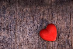 Red heart on wood background Stock Photo