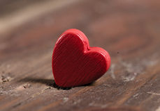 Red heart on wood background. Stock Photos