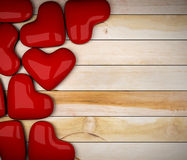 Red heart on wood floor Royalty Free Stock Images