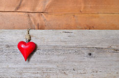 Red heart on wood Stock Image