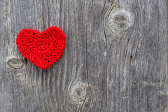 Red heart on a wood texture outdoor Stock Photo