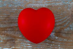 A red heart on the wooden background.  Stock Photography