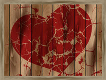 Red heart on a wooden background. Abstract cracked red heart on a wooden background Royalty Free Stock Images