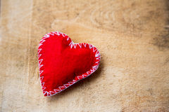 Red heart. On wooden background Stock Image