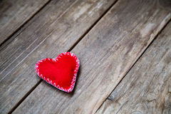 Red heart. On the wooden background Royalty Free Stock Image