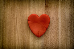 Red heart on a wooden background Stock Photos