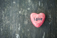 Red heart and wooden background in country style. Stock Photography
