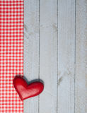 Red Heart on Wooden Background. Red heart decoration on grey wooden background with gingham check border and copyspace for your text Royalty Free Stock Photo