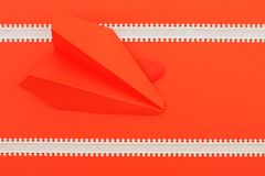 Red heart on the pink background with arrow line and paper airplanes stock photography