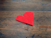 Red heart on wooden table Royalty Free Stock Photo