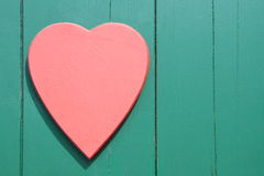 Red Heart on a wooden background. Red Heart on a green wooden background Stock Photography
