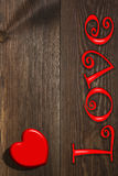 The red heart on the wooden background Royalty Free Stock Photos