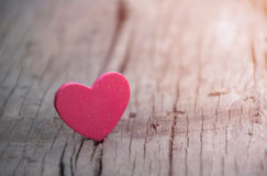 Red heart on wooden background Royalty Free Stock Image