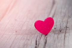 Red heart on wooden background Stock Image