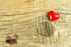 Red heart on a wooden background. The symbol of love. The memory of love. Royalty Free Stock Photos