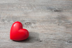 Red heart on wooden background Royalty Free Stock Images