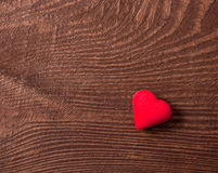 Red heart on wooden background Stock Photos