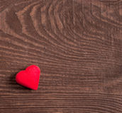Red heart on wooden background Royalty Free Stock Photos