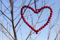 Red heart of wooden beads Royalty Free Stock Images