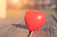 Red heart on the wooden bench Royalty Free Stock Photo