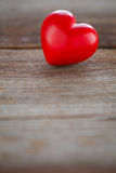 Red heart on wooden board Stock Images