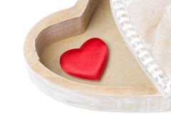 Red heart in a wooden box, isolated Royalty Free Stock Image