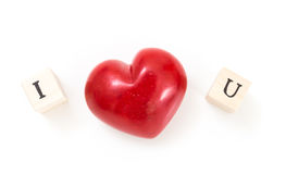 Red heart and wooden cubes with I and U, on white Royalty Free Stock Photos