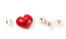 Red heart and wooden cubes with I and You, on white background. Stock Photo