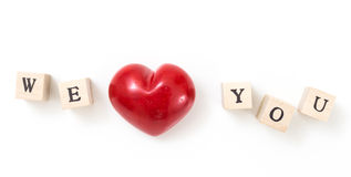 Red heart and wooden cubes with We and You Stock Image