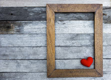 Red heart in wooden frame Stock Image