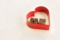 Red heart with wooden love letters Royalty Free Stock Photos