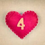 Red heart with wooden number 4 Royalty Free Stock Photography